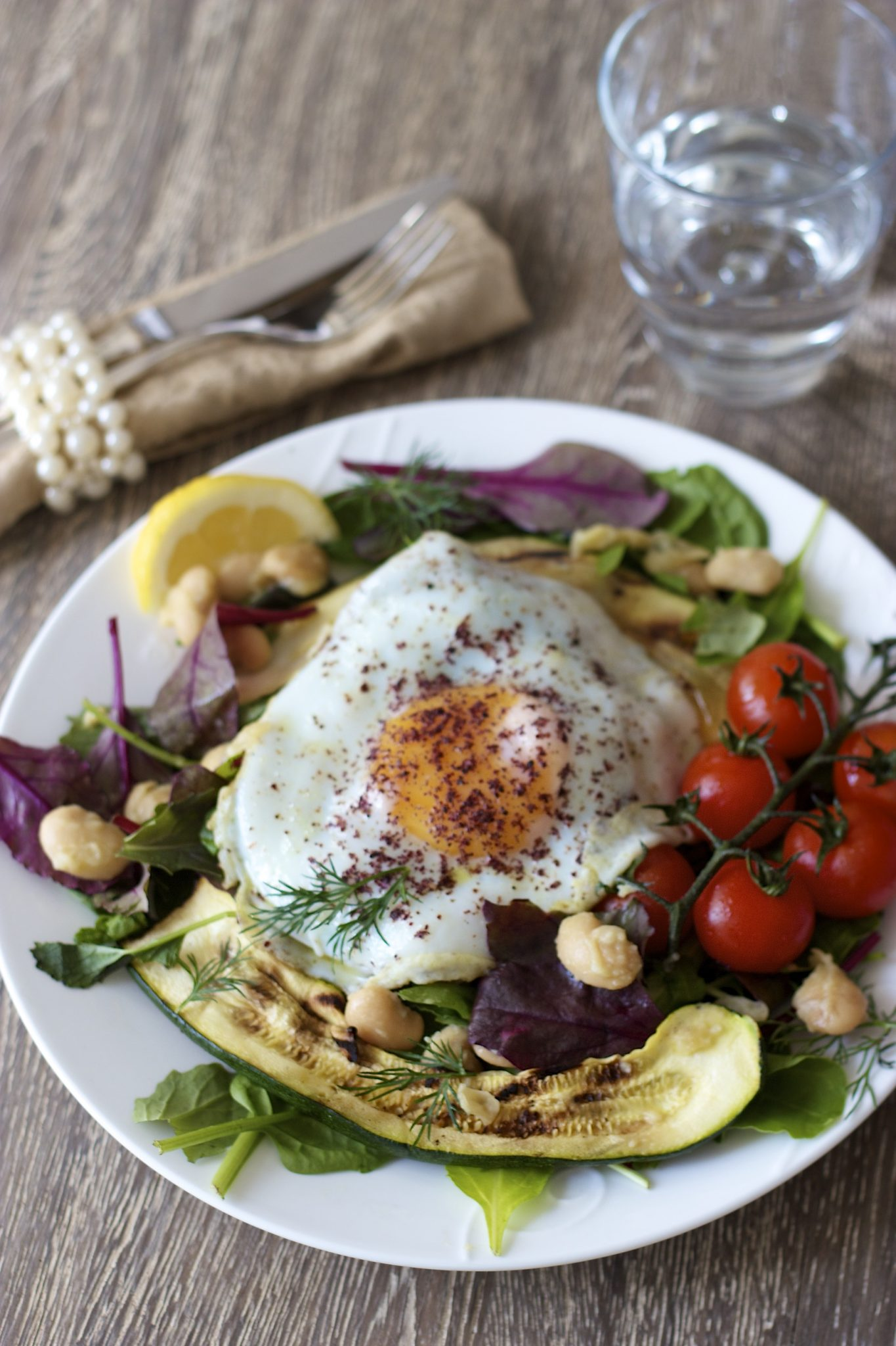 Mixed Greens Salad with Garlic Butter Beans Fried Egg and Sumac